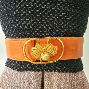 Brown leather belt with gold peacock buckle